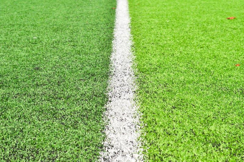 在橄榄球场的线 库存照片