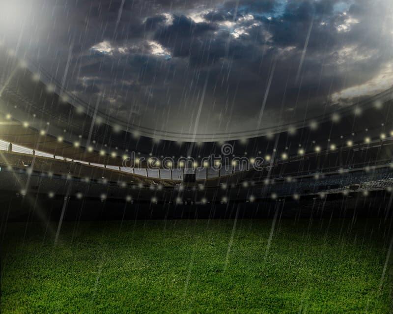 在橄榄球场的雨 免版税库存图片