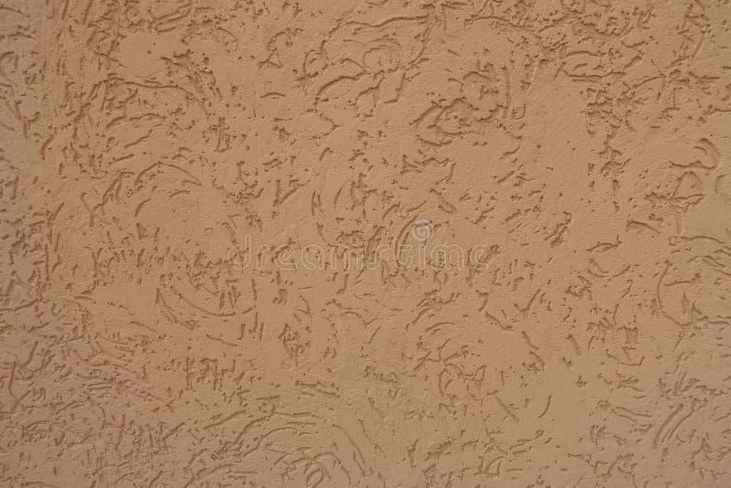 在橙色装饰膏药墙壁涂层的抽象样式 库存图片