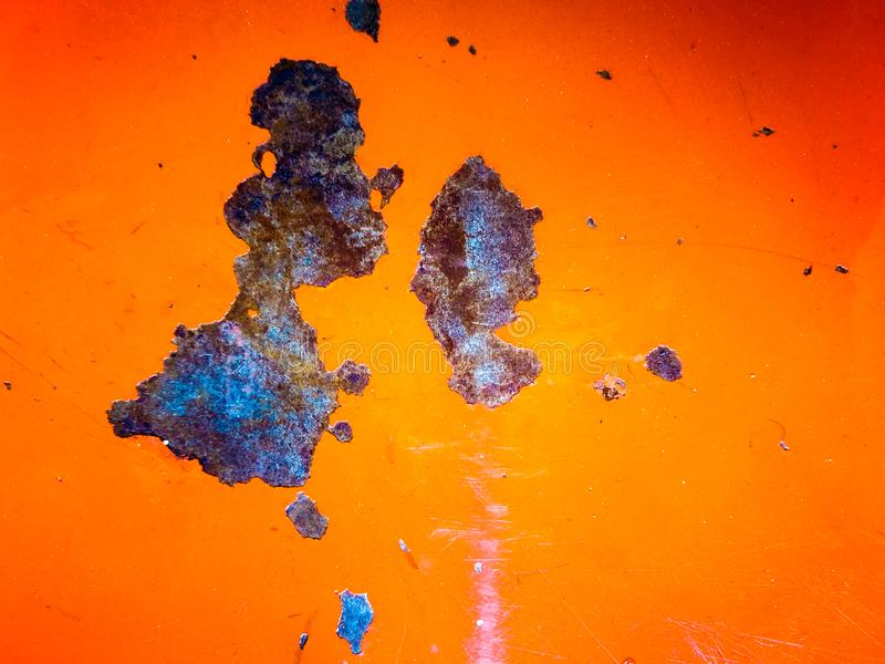 在橙色金属板的铁锈 免版税库存照片