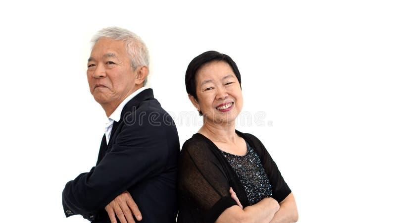 在正式服装的亚洲资深合伙人礼服 爱生活家庭Bu 库存图片