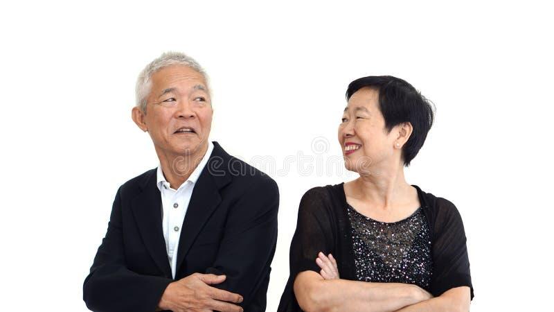 在正式服装的亚洲资深夫妇伙伴礼服 美丽  库存图片
