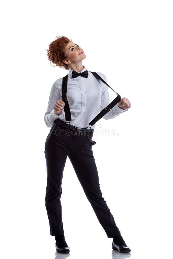 在正式衣服打扮的调情的女性舞蹈家 免版税库存照片