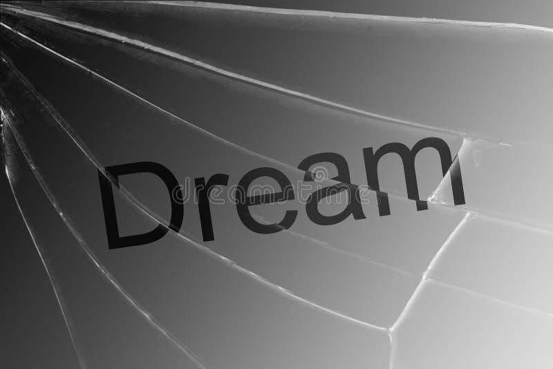 在残破的玻璃的文本梦想 梦想损失,希望,信念的概念 库存照片