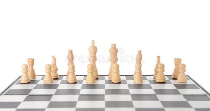 在比赛板的棋子反对白色背景 图库摄影