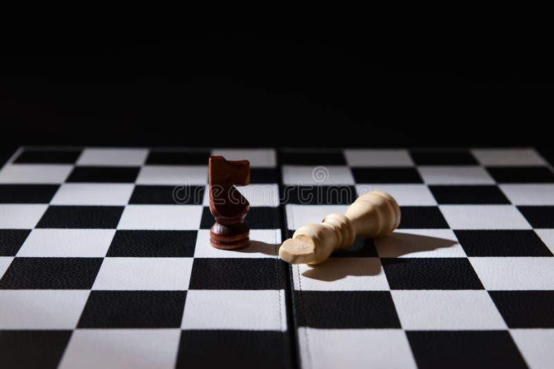 在比赛板的棋子 免版税图库摄影