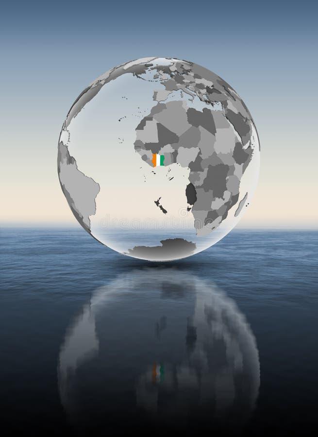 在水面上透亮的地球的象牙海岸 皇族释放例证