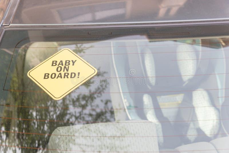 在汽车后窗的婴孩在船上贴纸 库存照片
