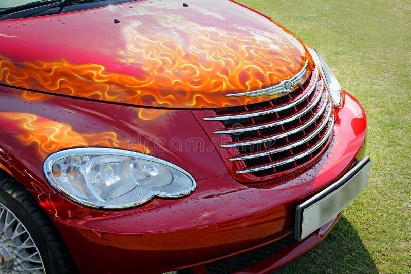 在汽车帽子的习惯火焰 免版税库存图片