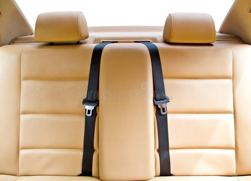在汽车的皮革后座 免版税图库摄影
