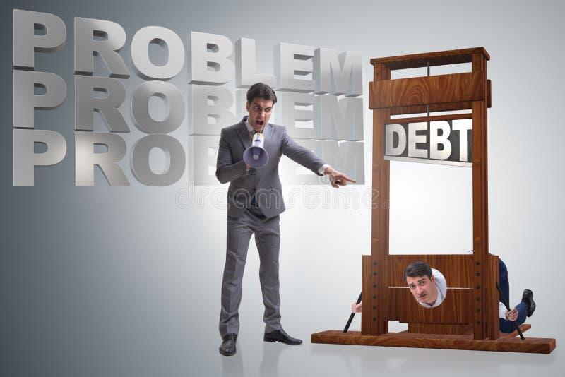 在沉重的债务企业概念的商人 库存照片