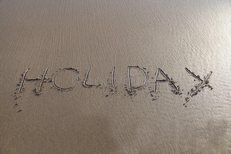 在沙子写的节假日字 免版税库存照片