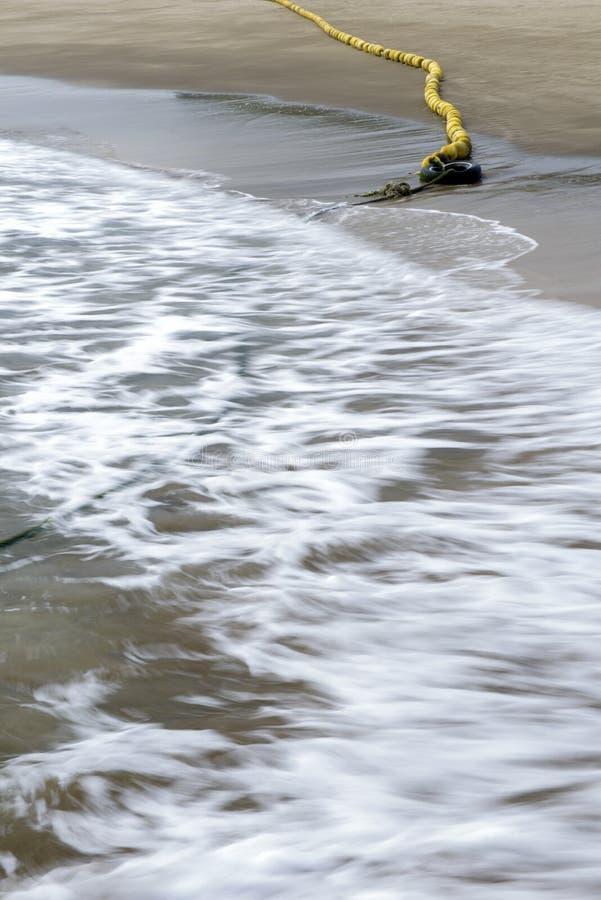 在沙子海滩的浮体, 库存照片