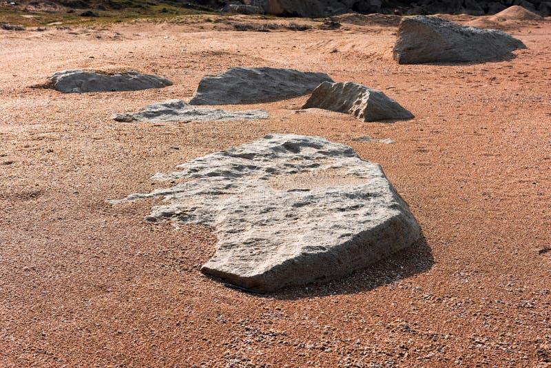在沙子的石板材 免版税库存图片