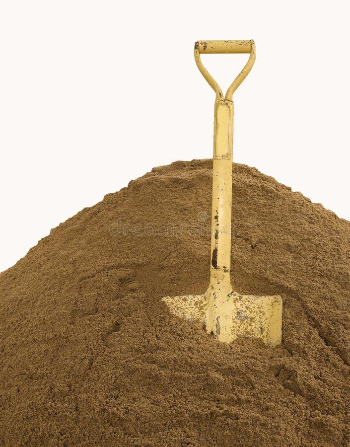 在沙子的铁锹 库存图片