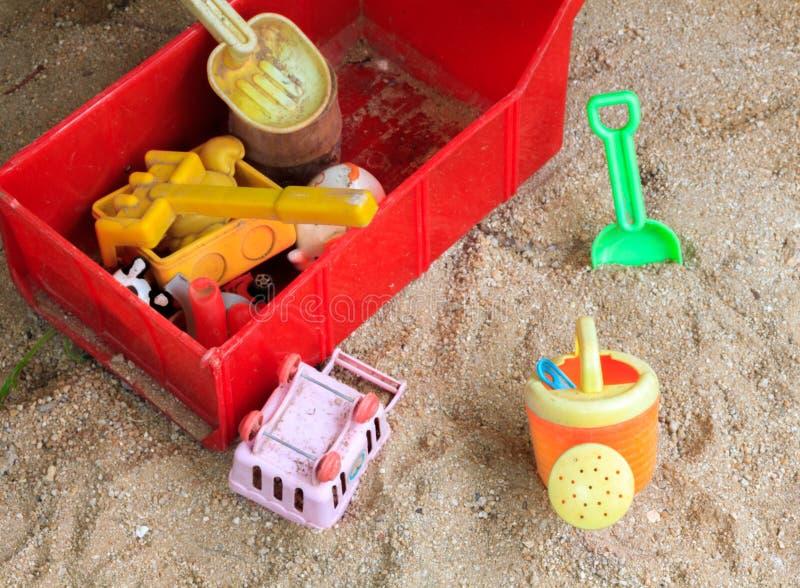 在沙子背景的玩具 库存照片