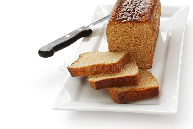 在法国姜蜂蜜香料上添面包 免版税库存图片