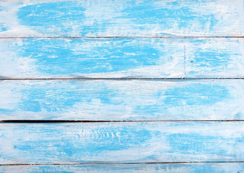 在法国样式的老白色和蓝色木织地不很细背景 库存图片