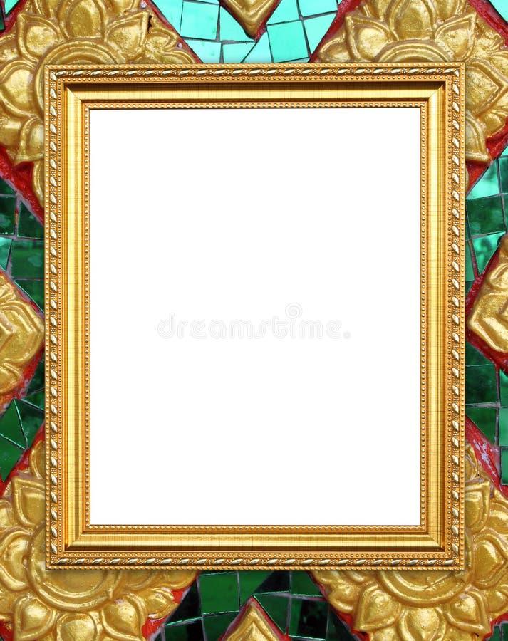 在泰国样式菩萨墙壁上的空白的金黄框架 免版税图库摄影