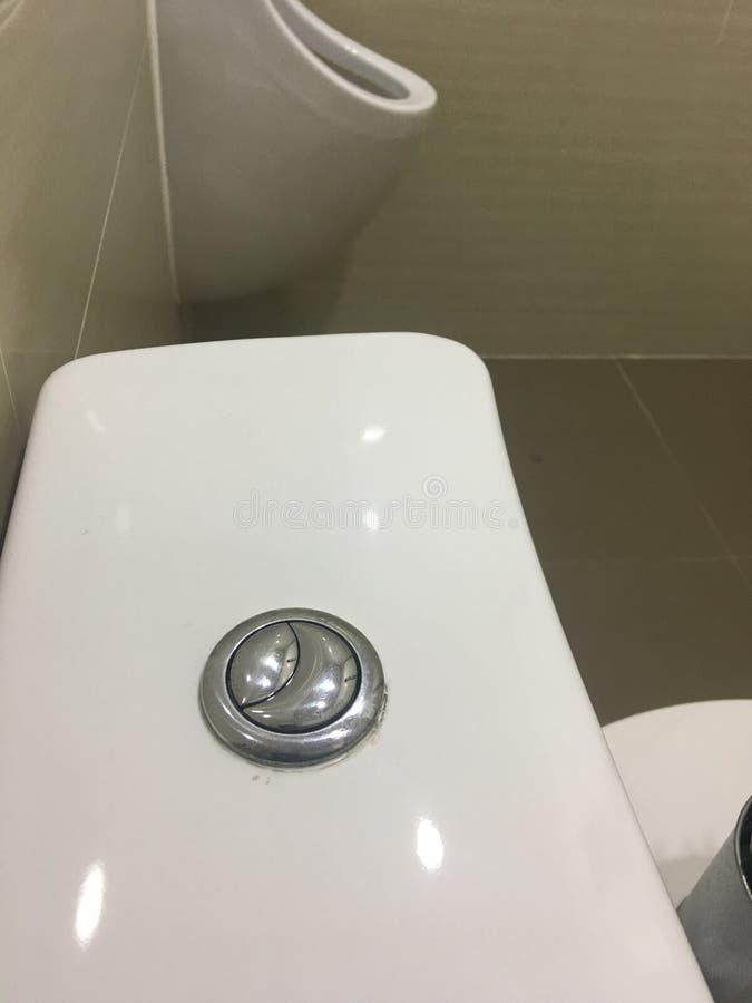 在洗手间的充足的按钮 库存图片