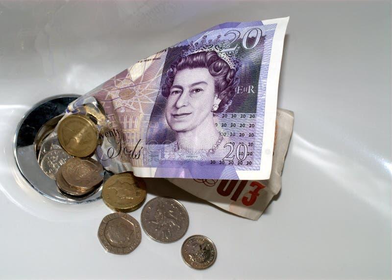 在流失下的货币 库存图片