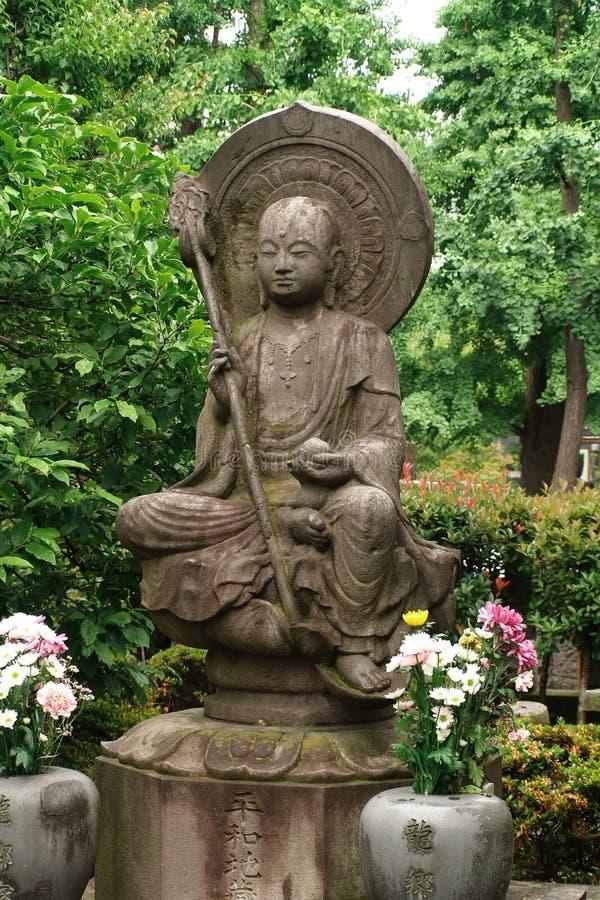 在浅草Kannon寺庙的雕象在东京 库存图片