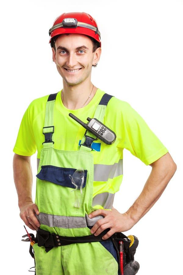 在浅绿色的制服的幼小英俊的承包商 库存图片