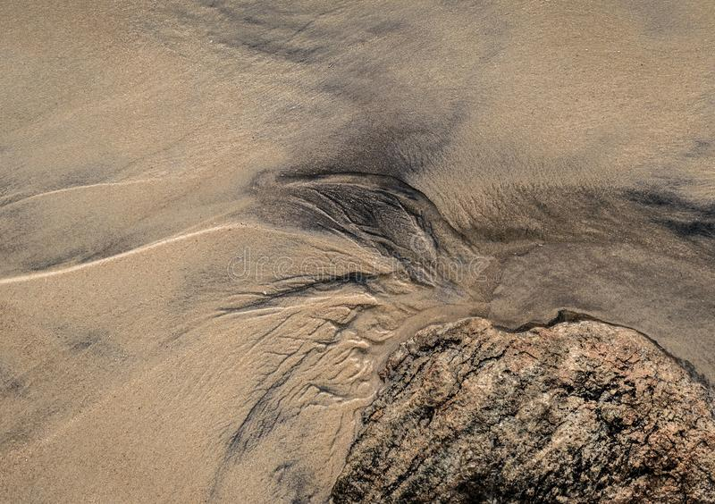 在海滩沙子的抽象样式 免版税库存照片
