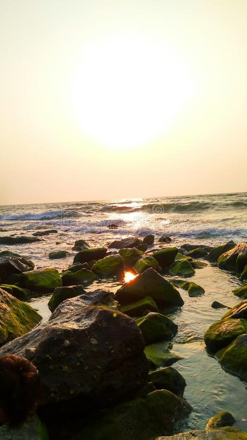 在海滩的晚上日落 库存照片