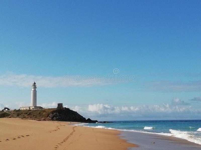 在海滩的灯塔 库存图片