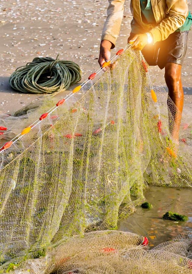 在海滩的Fishermans鱼网 免版税库存照片