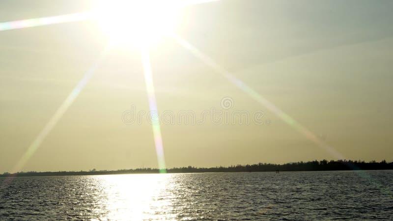 在海滩的太阳射线 库存照片