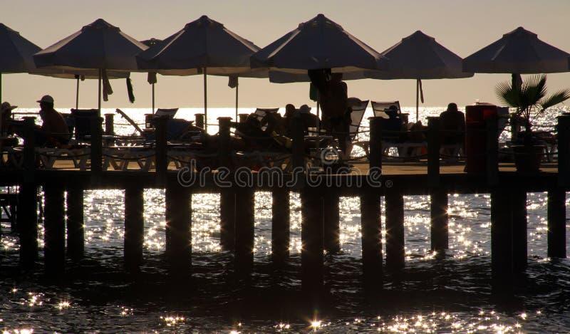 在海滩的懒惰下午 免版税库存图片