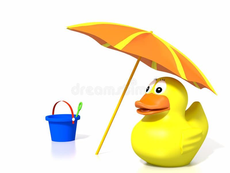 在海滩的橡胶鸭子 免版税库存图片
