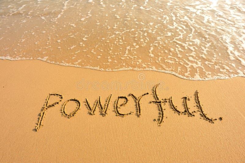在海滩的词强有力的凹道 库存图片