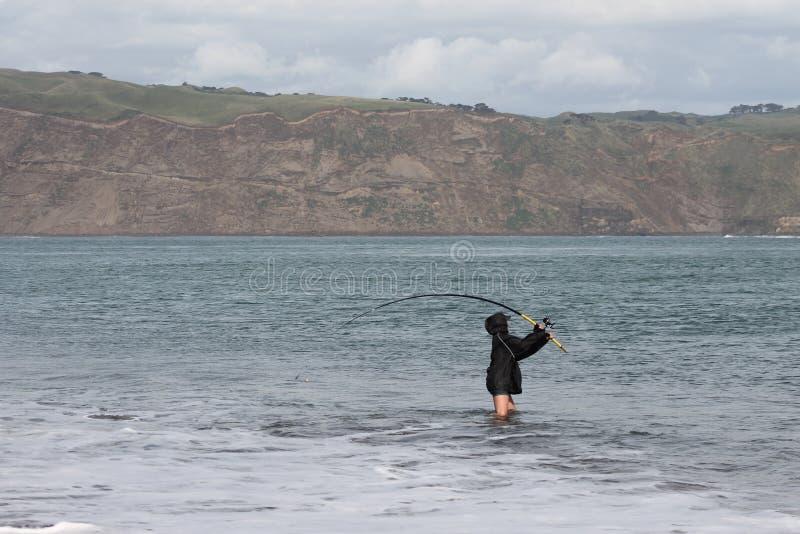 在海滩的Surfcasting 库存图片