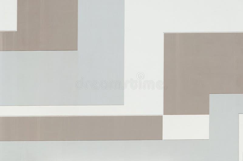 在淡色的大厦墙壁,几何抽象背景,长方形形状,被绘的纹理的样式与平角的 免版税库存图片