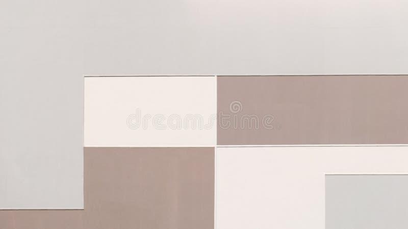 在淡色的大厦墙壁,几何抽象背景 库存照片
