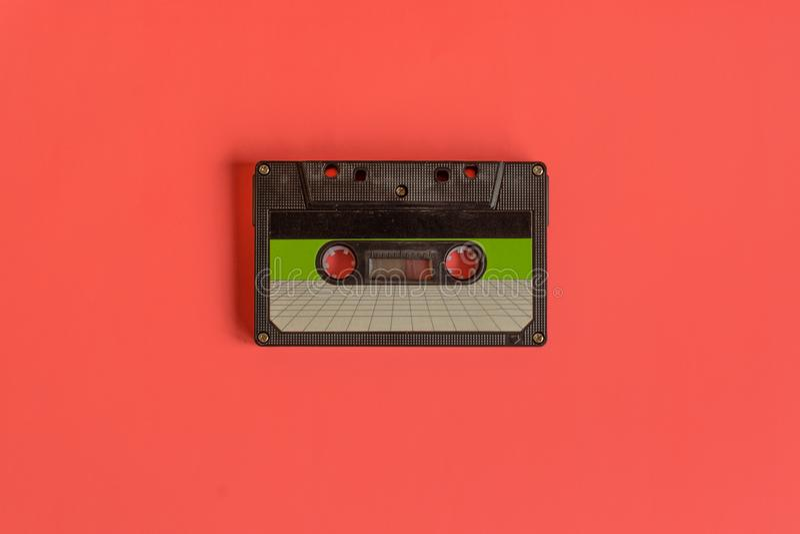 在淡色色的背景的卡型盒式录音机磁带 库存图片