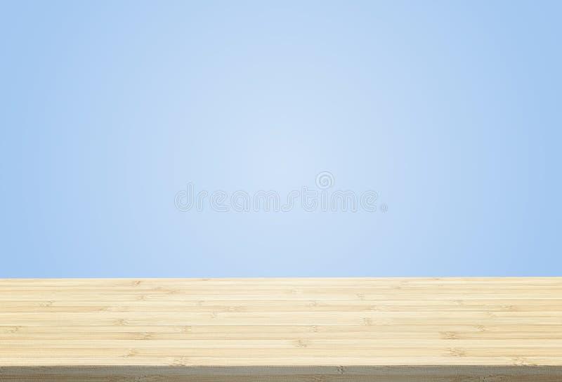 在淡色蓝色背景的层压制品的台式 库存图片
