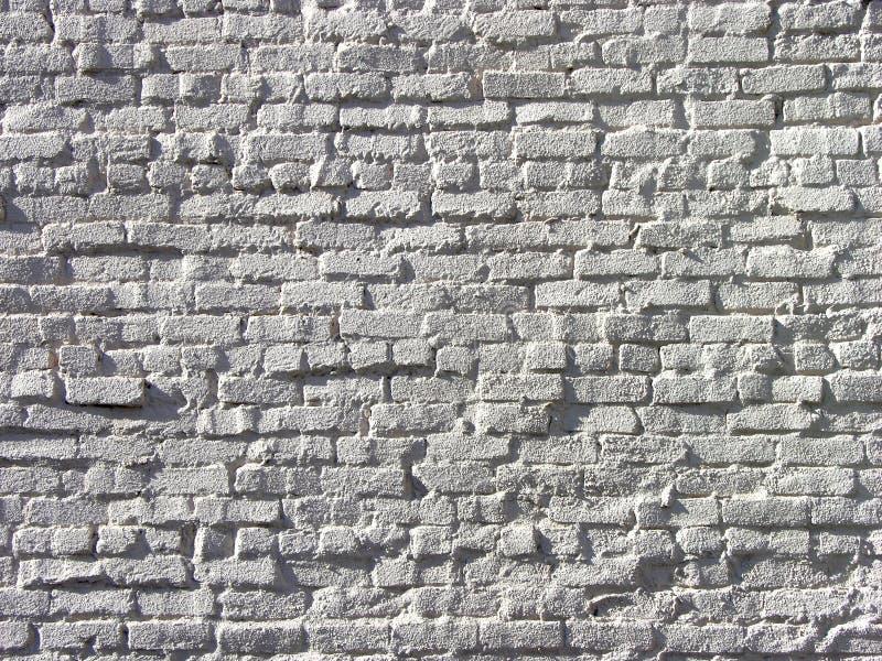 在深浮雕的白色砖砌 库存图片