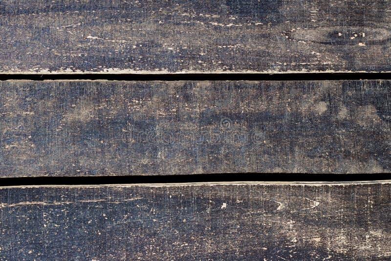 在深灰的Graunge老土气被风化的木背景 免版税图库摄影