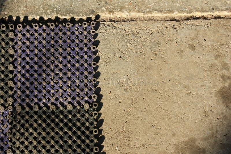 在混凝土的地毯 街道席子 ?? 库存照片