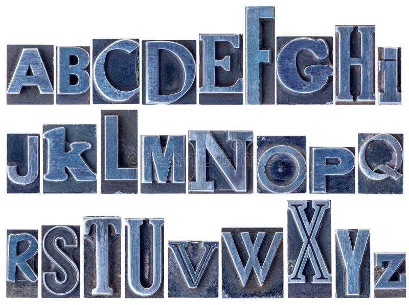 在混杂的活版金属类型的字母表 图库摄影