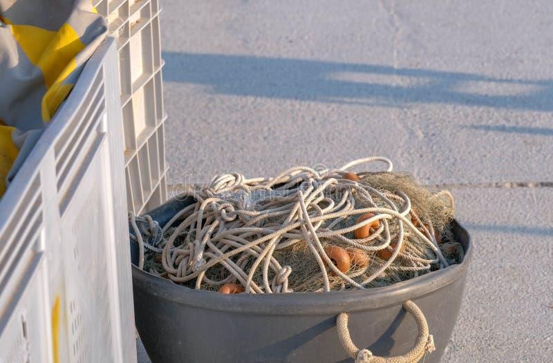 在渔具和设备的看法到一个大桶里 图库摄影