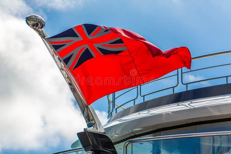 在游艇的红色少尉旗子 库存照片