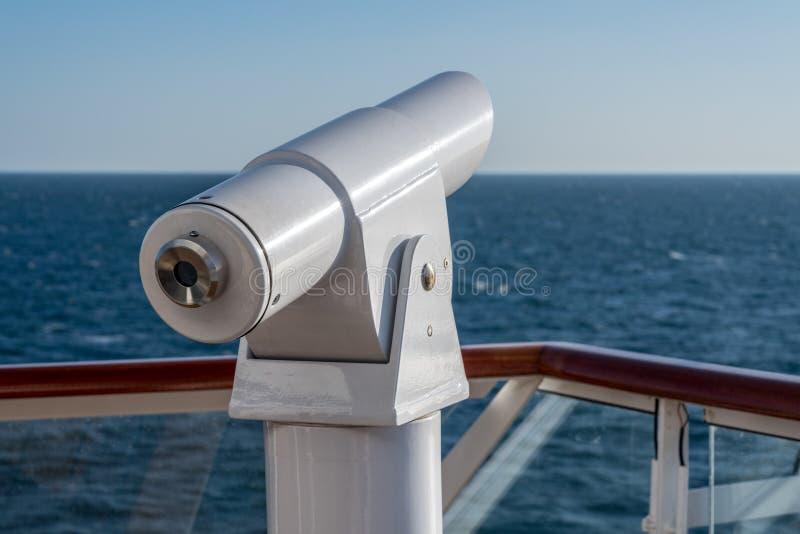 在游轮甲板的光学望远镜  图库摄影