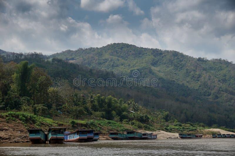 在湄公河的慢小船在老挝 图库摄影