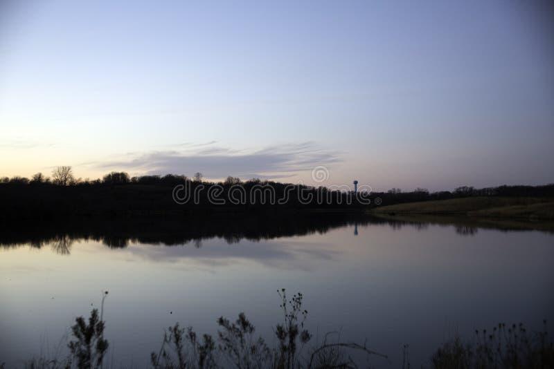 在湖水反映的水塔 库存图片