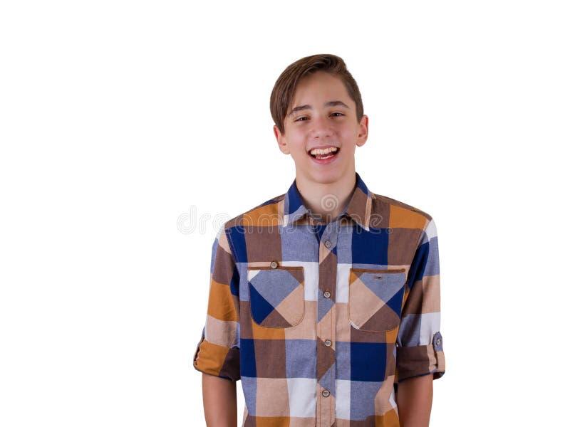 在演播室被拍摄的可爱的青少年的男孩画象  背景查出的白色 库存图片